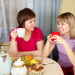 Royalty-Free Stock Photo: Girls  drinks tea and talking