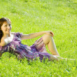 Girl rests in grass — Stock Photo #5722721