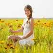 Girl in flowers meadow — Stock Photo #5723846