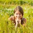 Girl lying at meadow grass — Stock Photo #5723861