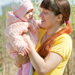 Mother with baby girl in spring — Stock Photo