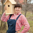 Royalty-Free Stock Photo: Woman with new birdhouse