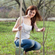 Woman planting tree outdoor — Stock Photo #5728056