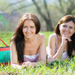 Happy women relaxing in park — Stock Photo #5728404