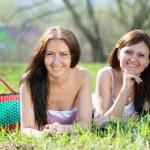 Happy women relaxing in park — Stock Photo