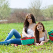 Girlfriends at green grass — Stock Photo