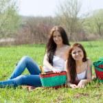 Girlfriends at green grass — Stock Photo
