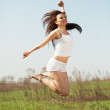 Jumping mid adult woman — Stock Photo #5728523