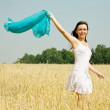 Woman in white dress at field - Stock Photo