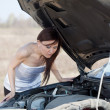 Woman repairing her car — Stock Photo