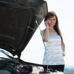 Woman calling by mobile near broken car — Stock Photo