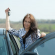 Woman holding keys to new car — Stock Photo