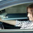 Woman is driving her car — Stock Photo