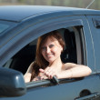 Woman in her car — Stock Photo