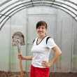 Happy  gardener with spade - Stock Photo