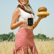 Girl with bread and kvass — Stock Photo