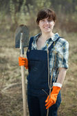 Woman with spade and sprout in spring — Stock Photo