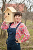 Woman with new birdhouse — Stock Photo