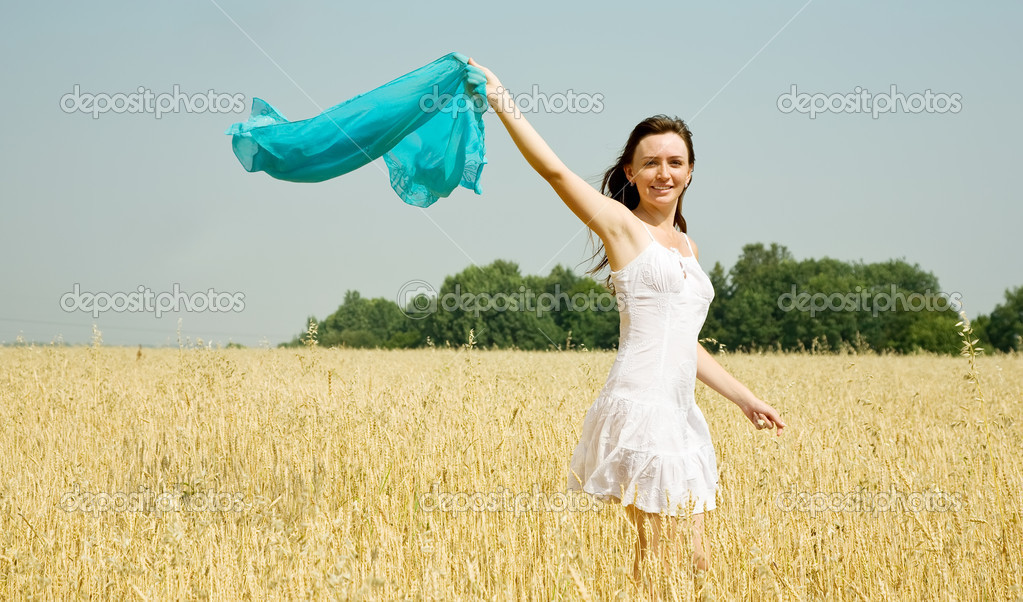 Happy young woman in white dress at field — Stock Photo #5728564