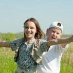 Happy teenager boy and girl — Stock Photo