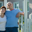 Happy couple against his residence — Stock Photo #6037910