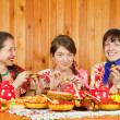 Women eating pancake during Pancake Week — Stock Photo #6037956
