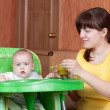 Mother feeding her 6 month old daughter — Stock Photo #6037971