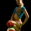 Sporty girl posing with ball — Stock Photo #6038602