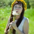 Happy girl blow dandelion — Stock Photo