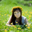Stock Photo: Reckle girl relaxing in meadow