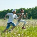 Two teens runs at meadow — Stock Photo