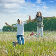 Boy and girl jumping at meadow — Stock Photo #6039361