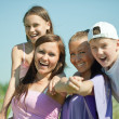 Two happy women with teens — Stock Photo #6039545