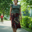 Mature woman walking in park — Stock Photo