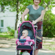 Mature woman with pram — Stock Photo