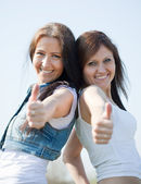 Happy women with thumb up — Stock Photo