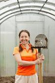 Mature gardener in greenhouse — Stock Photo