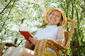 Mature woman in blossoming garden — Stock Photo