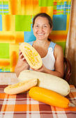 Mature woman with vegetable marrow — Stock Photo