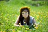 Reckle girl relaxing in meadow — Stock Photo