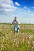 Teenager boy running at meadow — Stock Photo