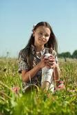 Teen girl in meadow grass — Stock Photo