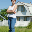 Happy woman in front of her residence — Stock Photo #6040050