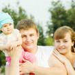 Stock Photo: Father and mother with baby
