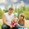 Parents with baby at park — Stock Photo #6040234
