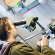 Jeweller is working with  microscope - Stock Photo