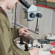 Jeweller  working with  microscope — Stock Photo