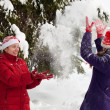 Women throwing snow — Stock Photo