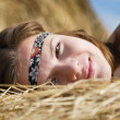 Girl on fresh hay — Stock Photo
