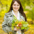 Stock Photo: Girl with autumn bouquet